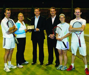 The victorious Savills team receiving The Irish Times Perpetual Trophy (from left): Gerry McCarthy; Anne Kiernan; Peter Dargan, The Irish Times; Society President Micheál O'Connor; Jill Horan; and, Conor Steen.