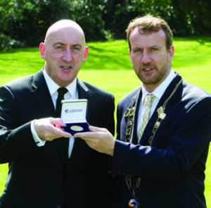 John Mulcahy of NAMA receives the Society of Chartered Surveyors Ireland Gold Medal from then Society President Micheál O'Connor.