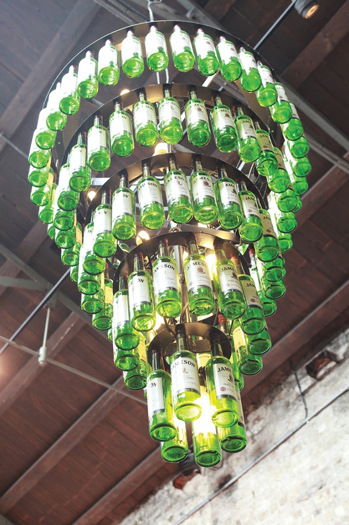 A chandelier made from Jameson bottles